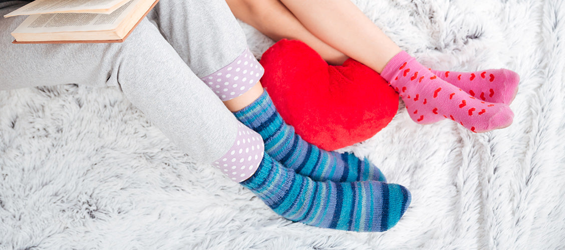 Two girls wearing pajamas and colorful socks - How to Style Crew Socks