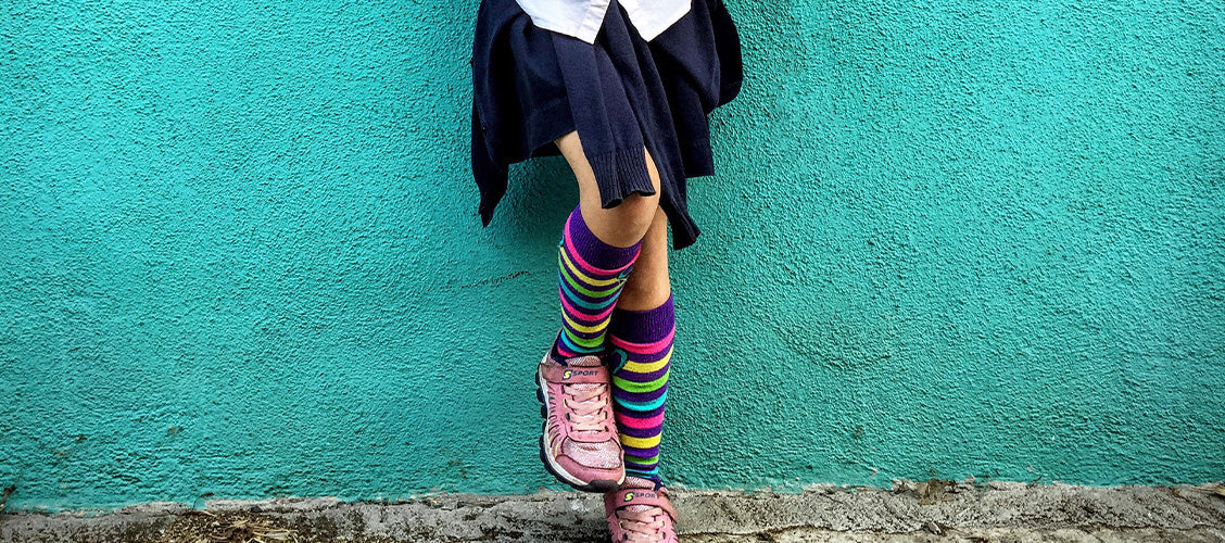 Girl wearing a skirt and socks - How to Style Crew Socks