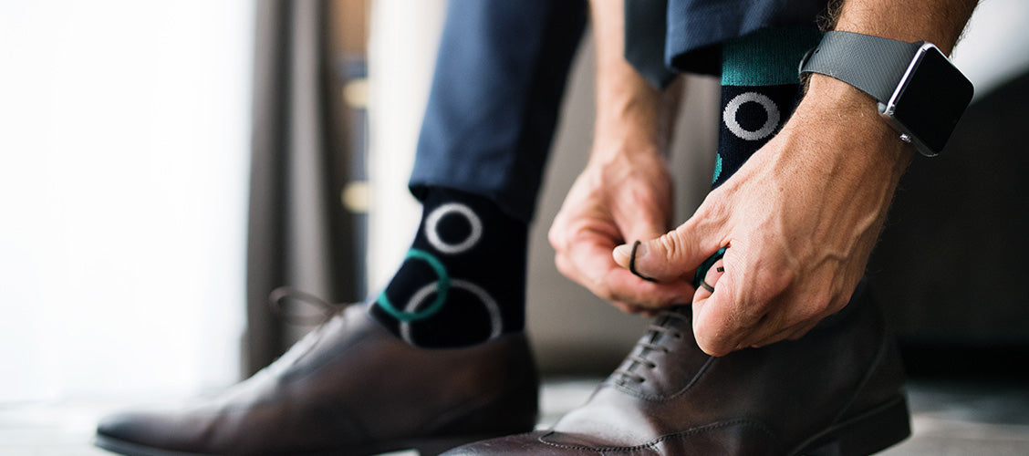 Man in suit tying shoes - How to Style Crew Socks