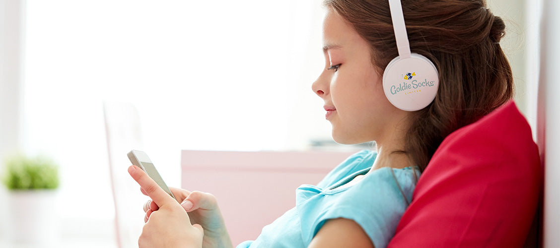 Girl listening to music on headphones - Songs with socks in the lyrics