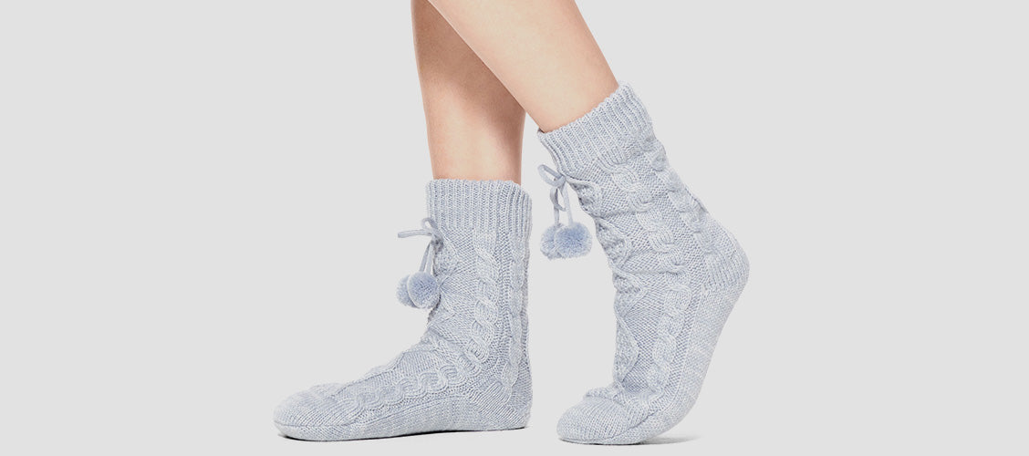 Woman wearing knit gray slipper socks - 10 Unexpected Socks
