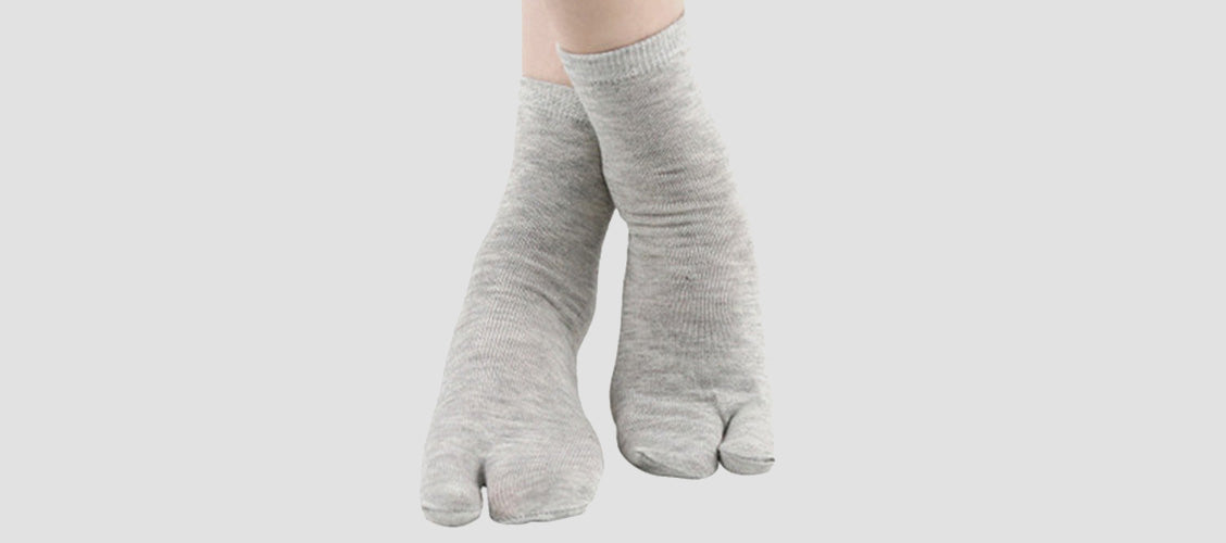 Woman wearing gray split-toe socks - 10 Unexpected Socks