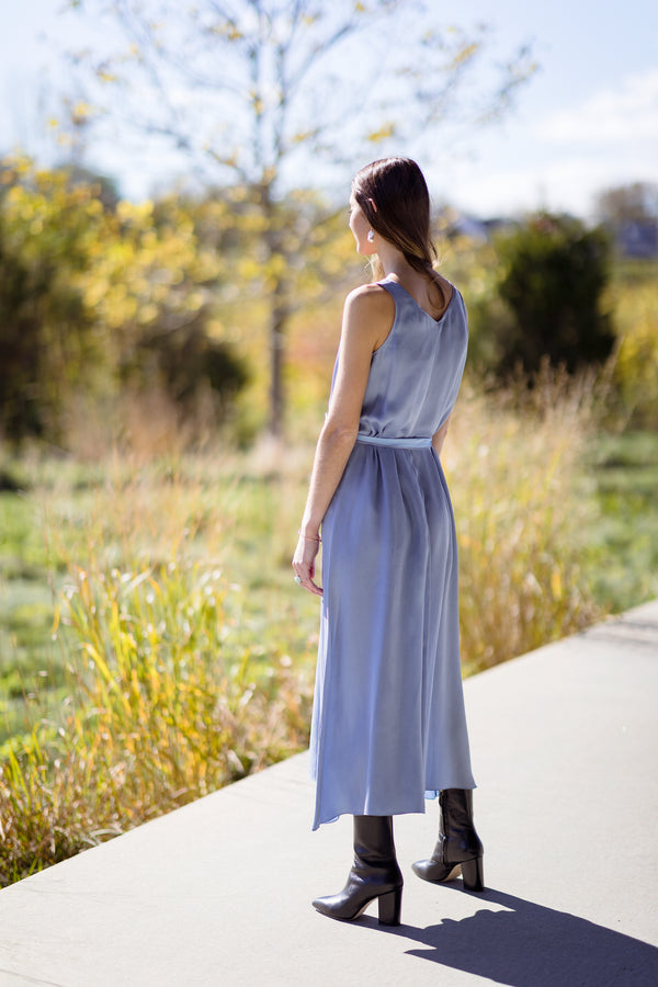 woman modeling back of Chic Satin Belted Dress on Hamptons farm