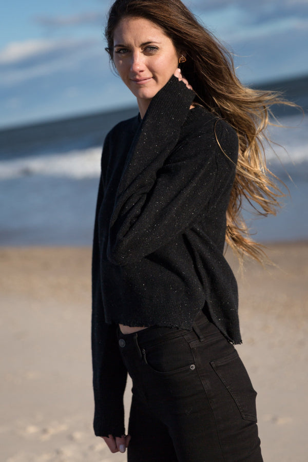 woman wearing August Crew Neck Sweater in black on beach