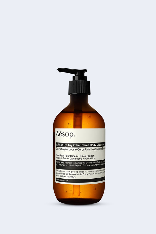 A bottle of 'A Rose By Any Other Name Body Cleanser' by Aesop on a white backdrop