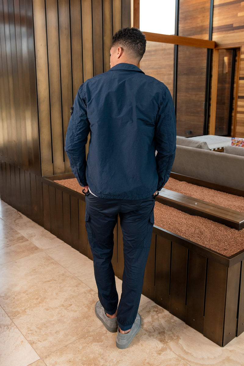 Man modeling 5-Pocket Trousers with Elastic Cuffs in Blue Marine from behind