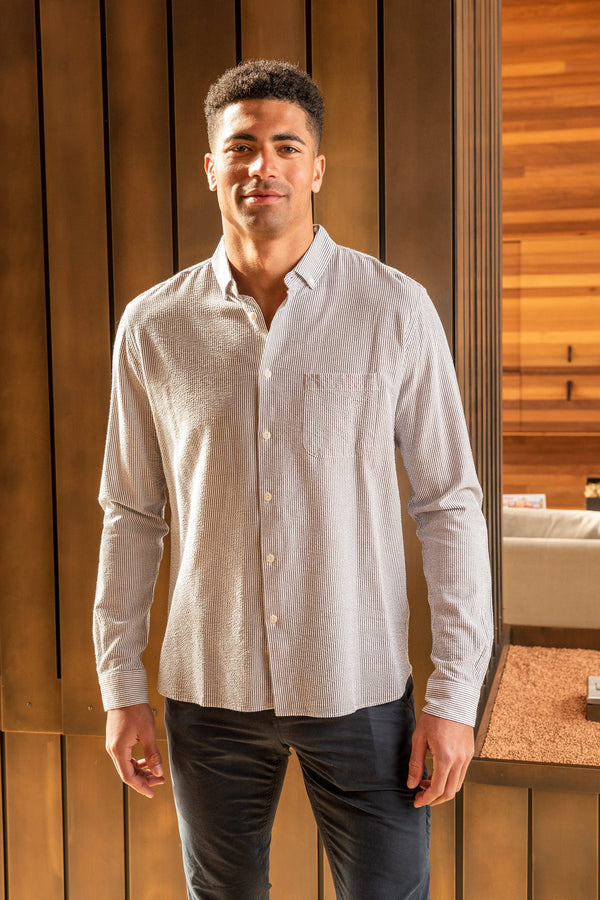 Man modeling the front of the Dean Shirt, from knees up against wooden backdrop