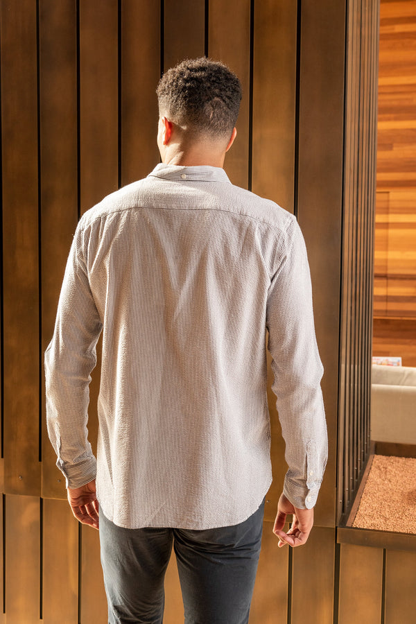 Man models the back of his Dean Shirt