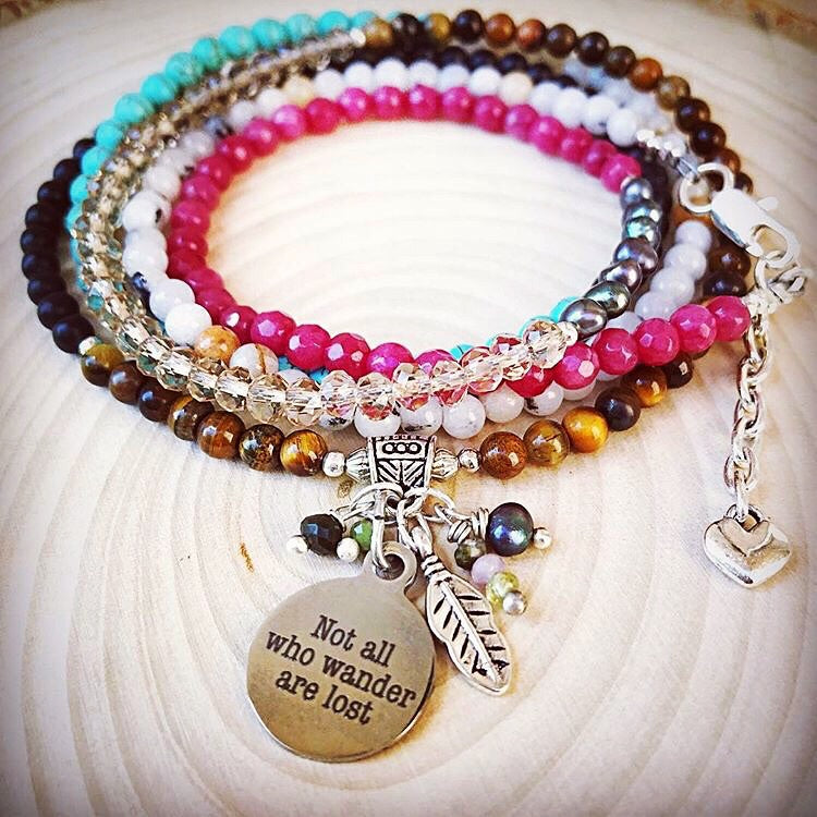 artisan gemstone wrap bracelet. Not all who wander are lost phrase. Wraps 5 times around the wrist with genuine gemstones.