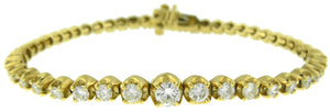 14KT YELLOW GOLD GRADUATED DIAMOND TENNIS BRACELET.