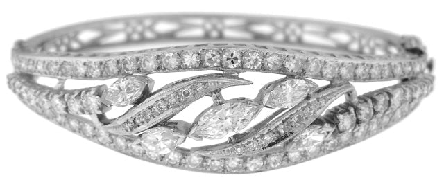 14KT WHITE GOLD ROUND AND MARQUISE DAIMOND BANGLE BRACELET.