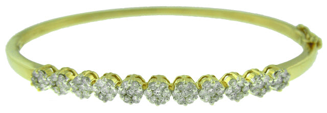 14KT YELLOW GOLD INVISIBLE SET DIAMOND BANGLE BRACELET.