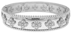18KT WHITE GOLD FLOWER DIAMOND BANGLE BRACELET.