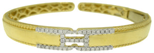 18KT YELLOW GOLD DIAMOND BANGLE BRACELET.
