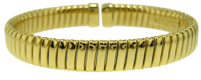 18KT YELLOW GOLD FLEXIBLE CUFF BANGLE BRACELET.