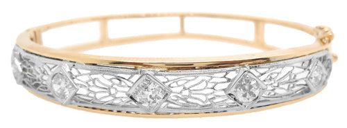14KT YELLOW AND WHITE GOLD PIERCED DESIGN DIAMOND BANGLE BRACELET