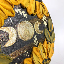 Pearlescent moon and sunflower