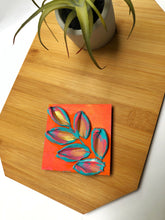 Blue, orange and gold magnet