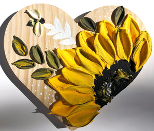 Wooden heart with sunflower
