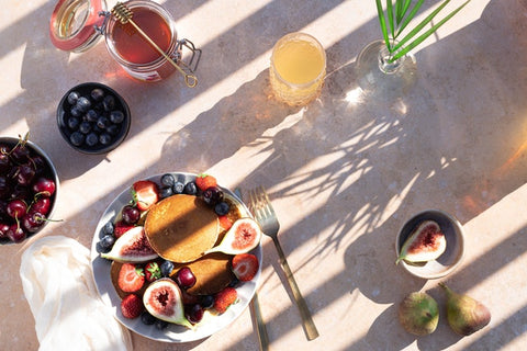 A healthy breakfast of fruits and juices and tea
