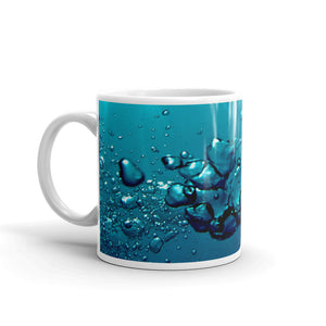 "Ceramic coffee mug printed with our distinctive and exclusive vivid ""Exhale"" bubble and water design."