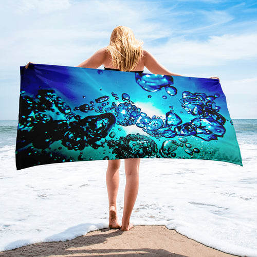 A bold overall print of sunlight water and bubbles on our popular bath or beach towel.