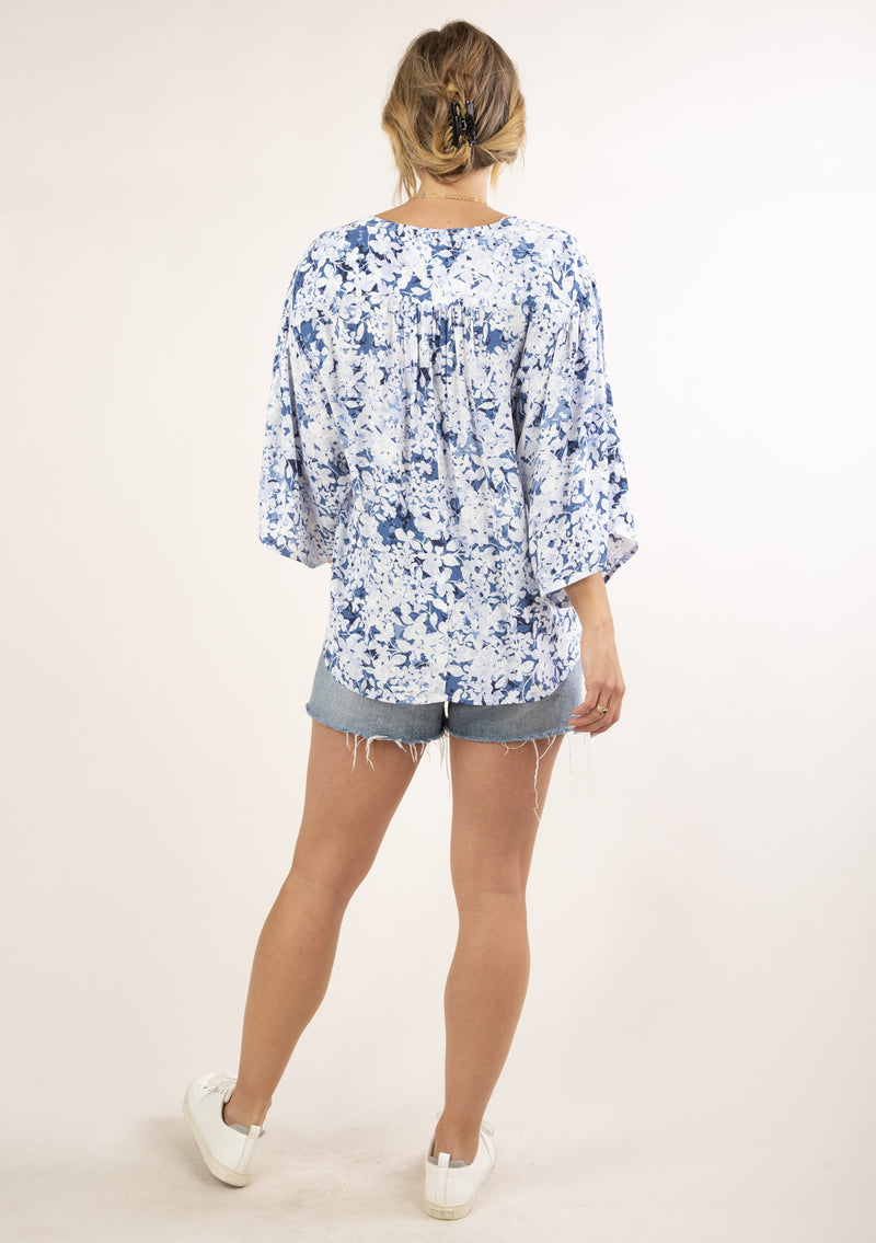 RELAXED FIT FLORAL WRAP TOP- SKY/BLUE - RETAIL STORE