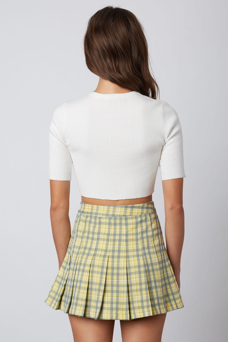 PLAID PLEATED SKIRT WITH HIDDEN SHORTS- YELLOW - RETAIL STORE