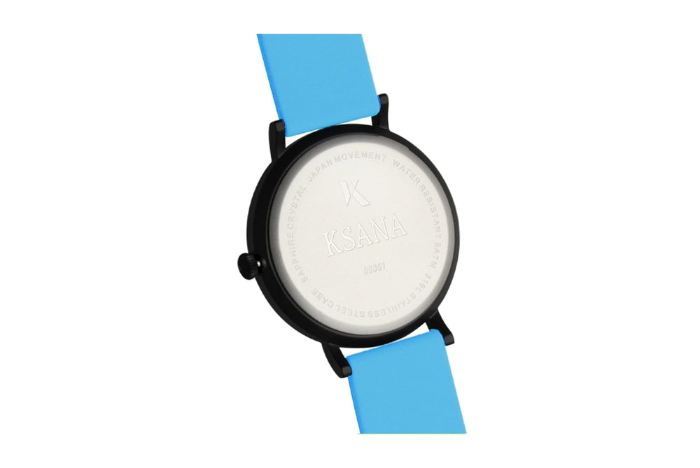 Neon blue silicone watch with matte black watch case. Ksana engraved with unique serial number. Colourful, neon watch strap in neon blue.