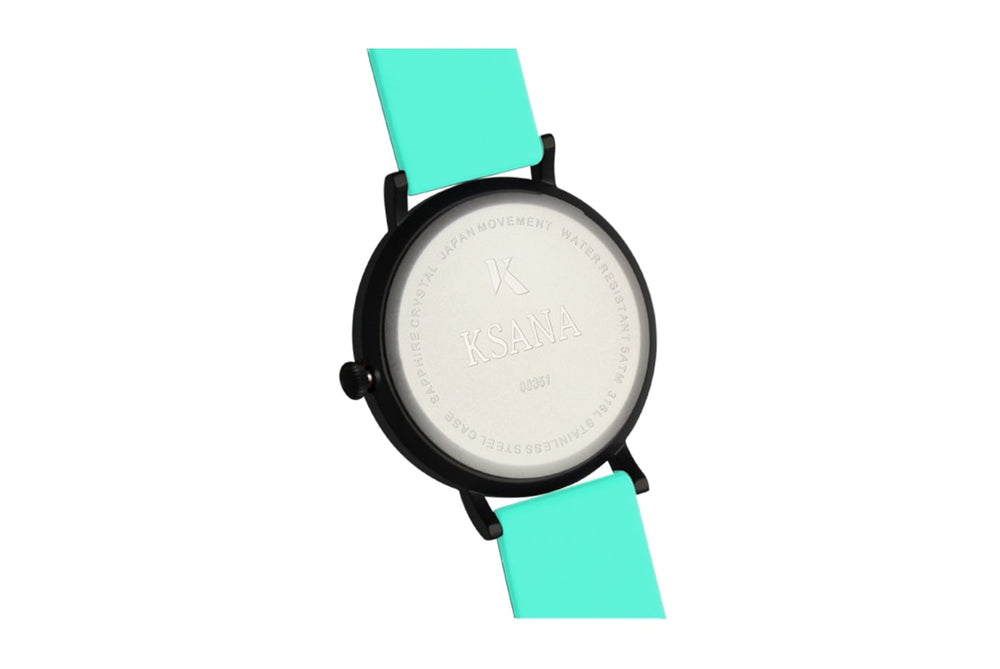 Mint green silicone watch with matte black watch case. Ksana engraved with unique serial number. Colourful, neon watch strap in mint green.
