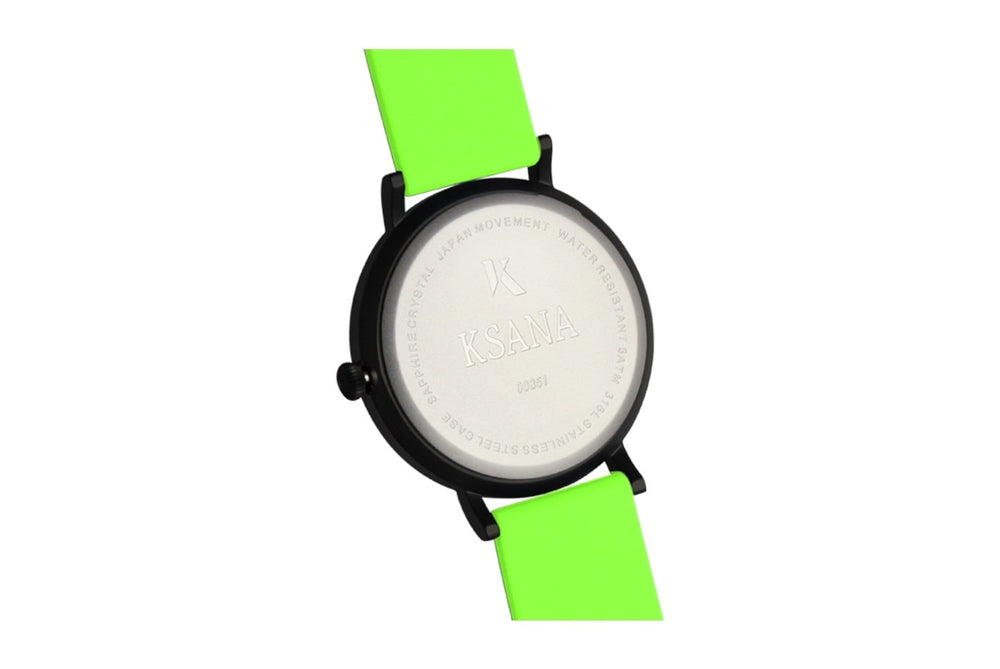 Neon green silicone watch with matte black watch case. Ksana engraved with unique serial number. Colourful, neon watch strap in green.