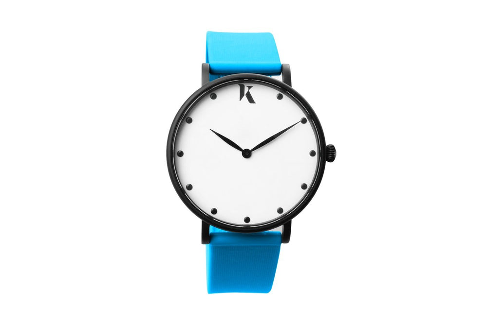 Neon blue silicone watch with matte black watch case. Colourful, neon watch strap in neon blue.