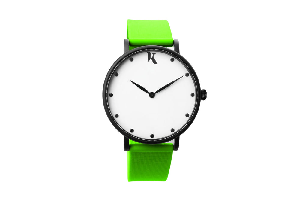 Neon green silicone watch with matte black watch case. Colourful, neon watch strap in green.