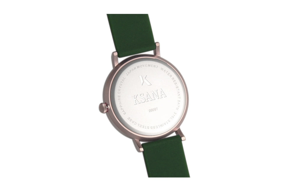 Dark Green and rose gold watch. Ksana engraved on the reverse along with a unique serial number. Vegan silicone watch strap with minimalist watch face design.