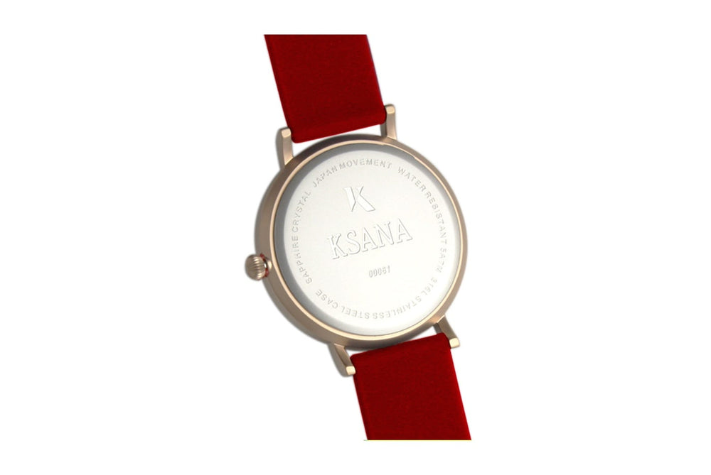 Dark red and rose gold watch. Ksana engraved on the reverse along with a unique serial number. Vegan silicone watch strap with minimalist watch face design.