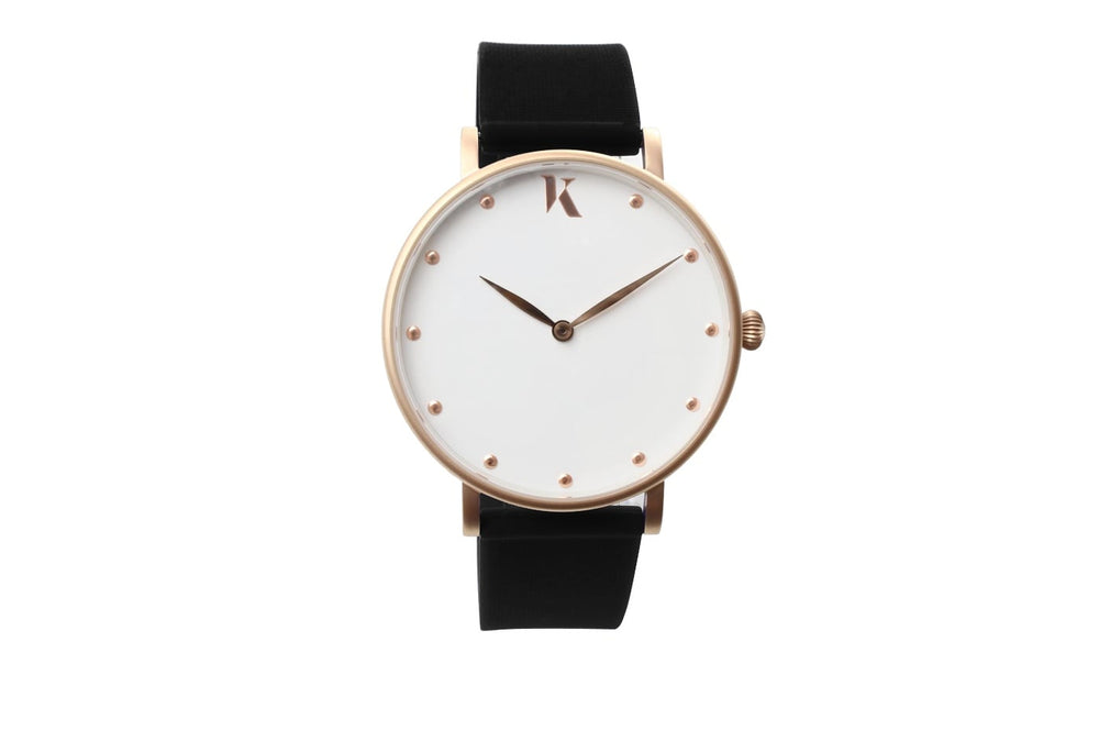 Black and rose gold watch. Vegan silicone watch strap with minimalist watch face design.