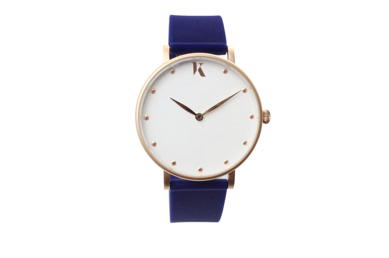 Dark blue and rose gold watch. Vegan silicone watch strap with minimalist watch face design.