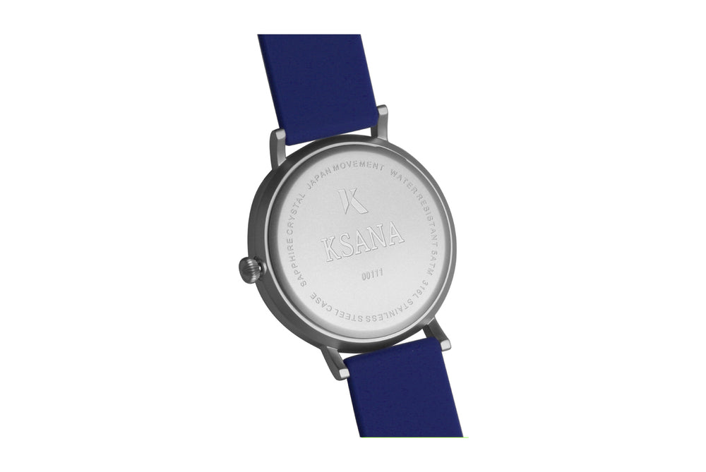 Dark blue and silver watch. Ksana engraved on the reverse along with a unique serial number. Vegan silicone watch strap with minimalist watch face design.