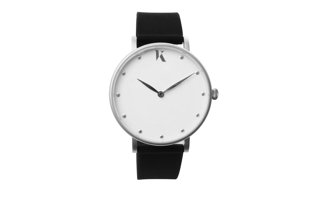 Black and silver watch. Vegan silicone watch strap with minimalist watch face design.