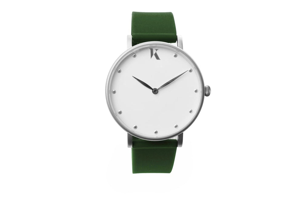 Dark Green and silver watch. Vegan silicone watch strap with minimalist watch face design.