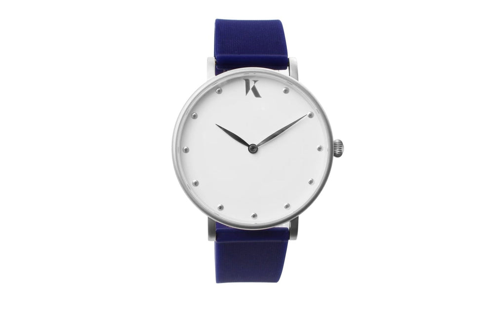 Dark blue and silver watch. Vegan silicone watch strap with minimalist watch face design.