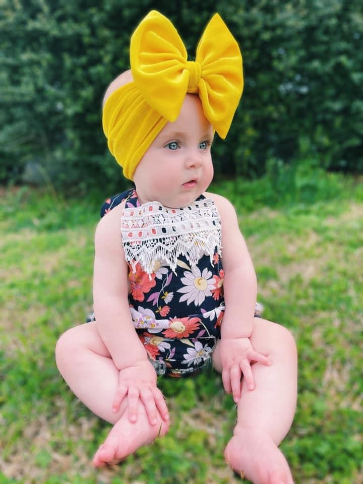 Baby Girl Outside with Yellow Velvet Bow and Romper