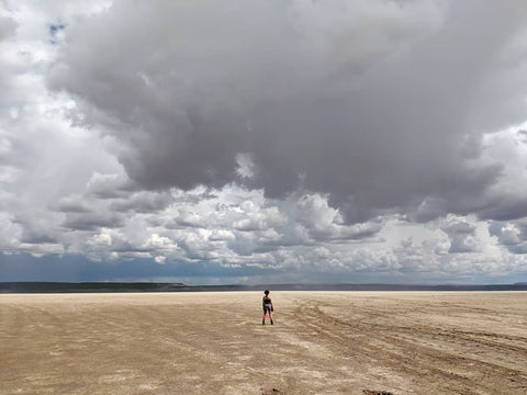 Woman standing in middle of Alvord Desert in eastern Oregon