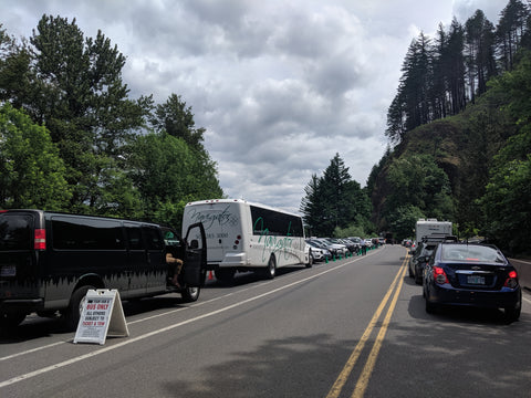 Line of cars waiting to park to see Multnomah Falls in the Columbia River Gorge