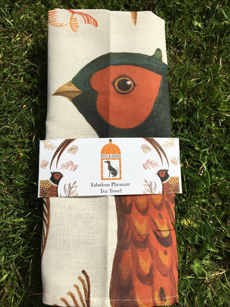 A linen/cotton blend tea towel depicting a pheasant and ferns with wrap around packaging