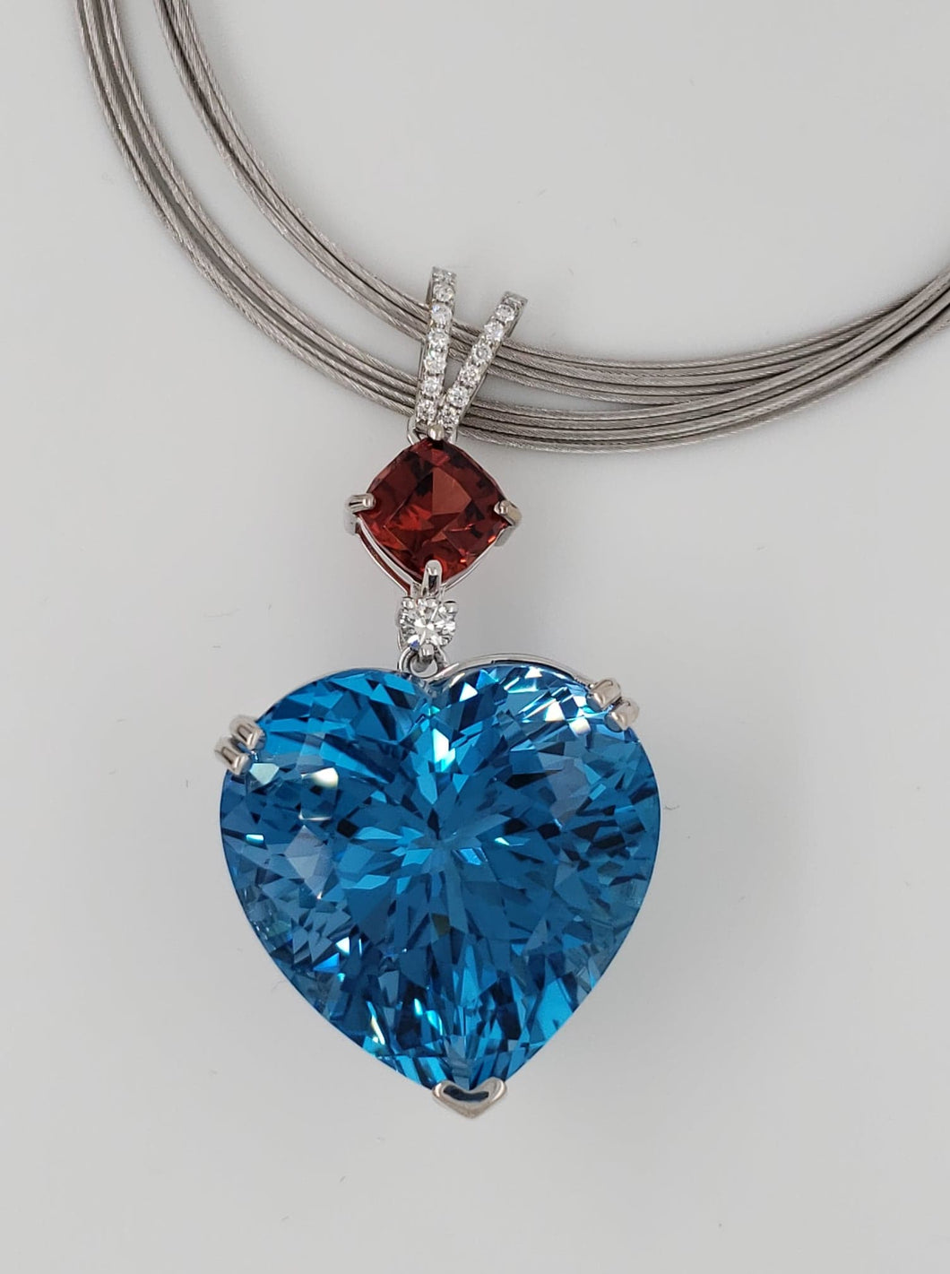 80ct London Blue Topaz and 3.5ct Malaya Imperial Garnet and Diamond Pendant