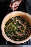 Minestra Maritata, also known as Italian Wedding Soup, a hearty soup with pork and sausage and a variety of greens