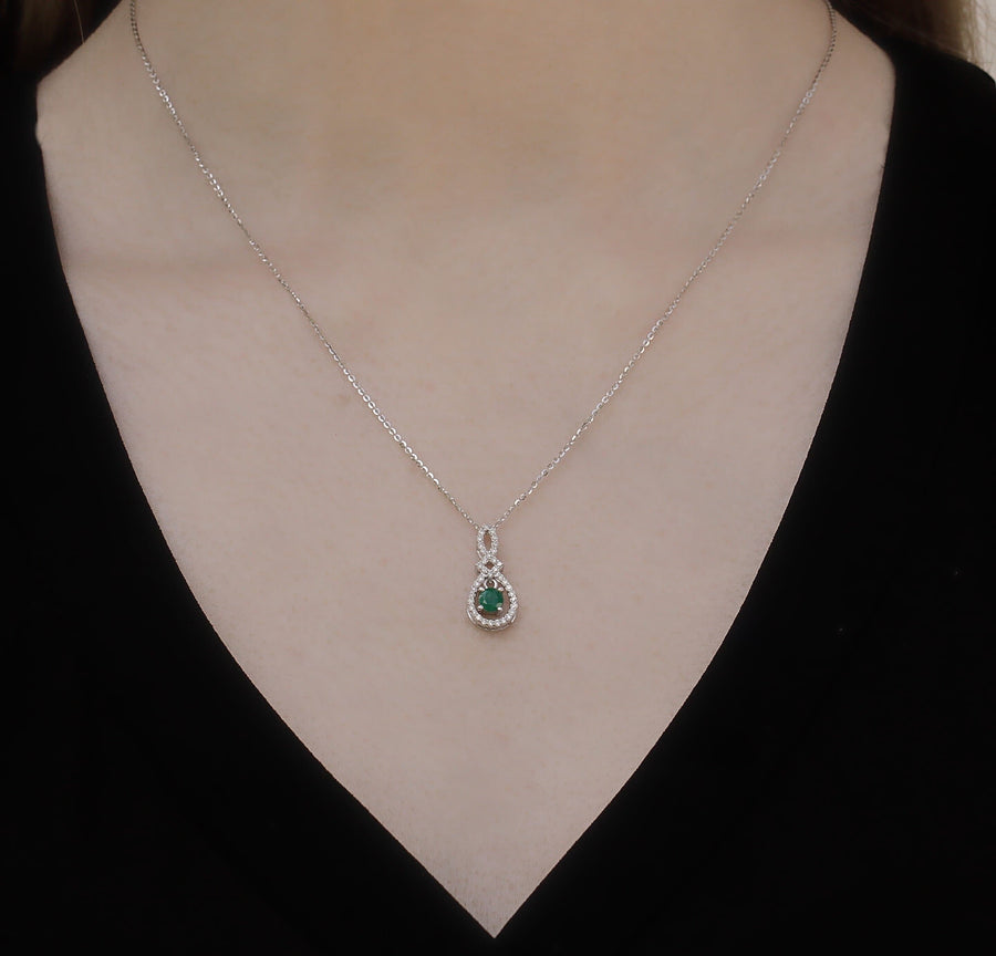 10KT WHITE GOLD 0.21CTTW DIAMOND AND EMERALD PENDANT