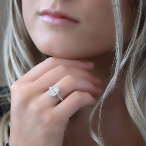 18kt White Gold 1.58cctw Oval shaped Halo Engagement Ring