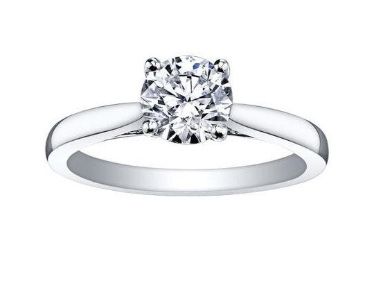 14KT WHITE GOLD 0.71CT ROUND CANADIAN DIAMOND SOLITAIRE WITH PEEK-A-BOO DIAMOND